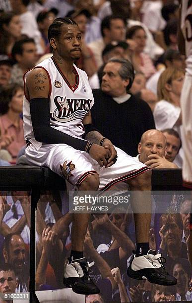 Allen Iverson of the Philadelphia 76ers sits on the scores table during a time out in the first half of game three of the NBA Finals against the Los...