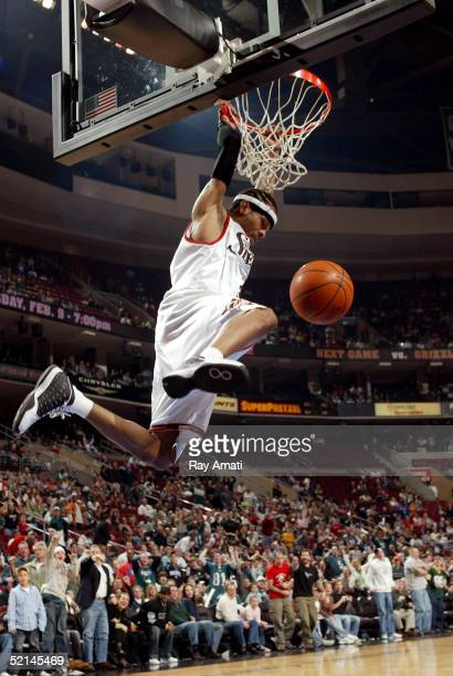 Allen Iverson of the Philadelphia 76ers slams one in against the defense of the Los Angeles Clippers on February 6 2005 at the Wachovia Center in...