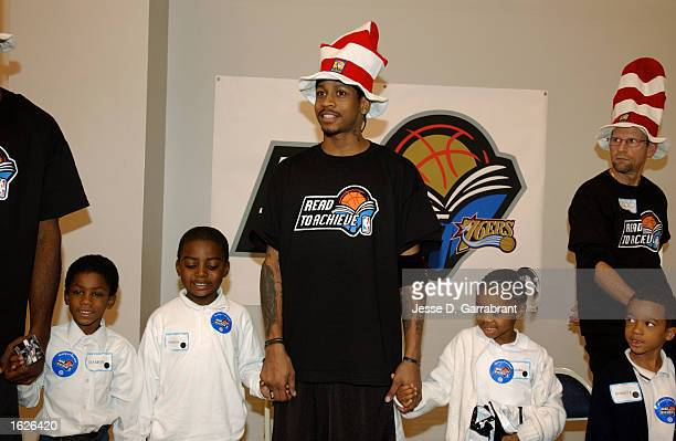 Allen Iverson of the Philadelphia 76ers smiles during the NBA Read to Achieve program at Mann Elementary School on October 21 2002 in Philadelphia...