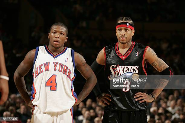 Allen Iverson of the Philadelphia 76ers stands next to Nate Robinson of the New York Knicks on November 26 2005 at Madison Square Garden in New York...