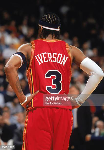 Allen Iverson of the Philadelphia 76ers stands on the court with his hands on his hip during a game against the Golden State Warriors at The Arena in...