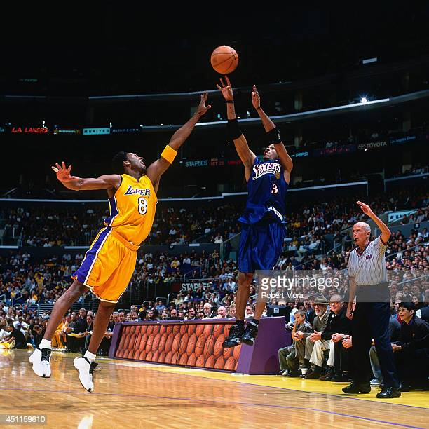 Allen Iverson of the Philadelphia 76ers takes a shot against Kobe Bryant of the Los Angeles Lakers at the Staples Center on December 5 2000 NOTE TO...