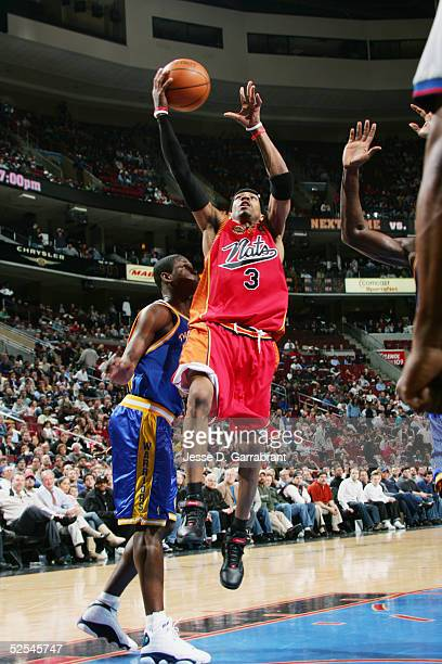 Allen Iverson of the Philadelphia 76ers takes the ball to the basket during the game against the Golden State Warriors on March 8 2005 at the...