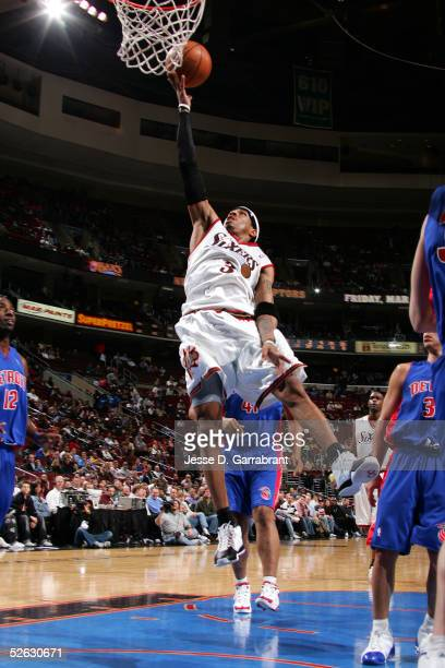 Allen Iverson of the Philadelphia 76ers takes the ball to the basket during the game against the Detroit Pistons on March 23 2005 at the Wachovia...