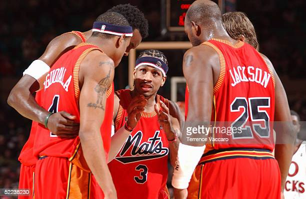 Allen Iverson of the Philadelphia 76ers talks in a huddle with teammates Andre Iguodala Samuel Dalembert Marc Jackson and Kyle Korver during a game...