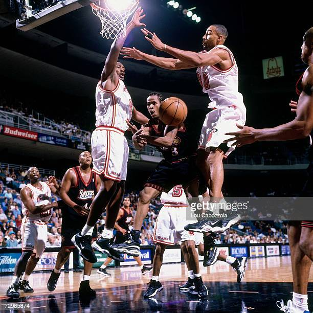 Allen Iverson of the Philadelphia 76ers throws a pass against the Miami Heat during a 1998 NBA Game played at the Orlando Arena in Orlando Florida...