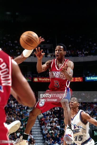 Allen Iverson of the Philadelphia 76ers throws a pass against the Utah Jazz during a 1997 NBA Game played at the Delta Center in Salt Lake City Utah...