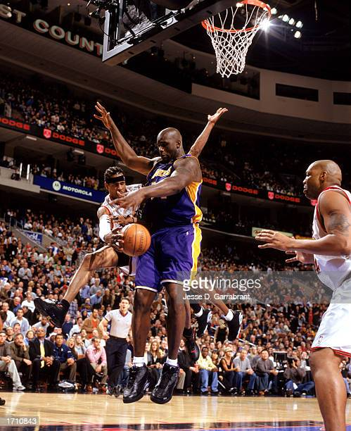 Allen Iverson of the Philadelphia 76ers tries passing around Shaquille O'Neal of the Los Angeles Lakers during the game at First Union Center on...