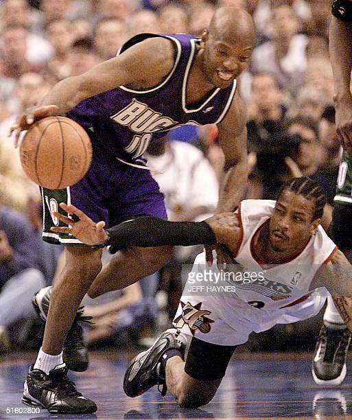 Allen Iverson of the Philadelphia 76ers tries to steal the ball from Sam Cassell of the Milwaukee Bucks in game seven of their NBA Eastern Conference...