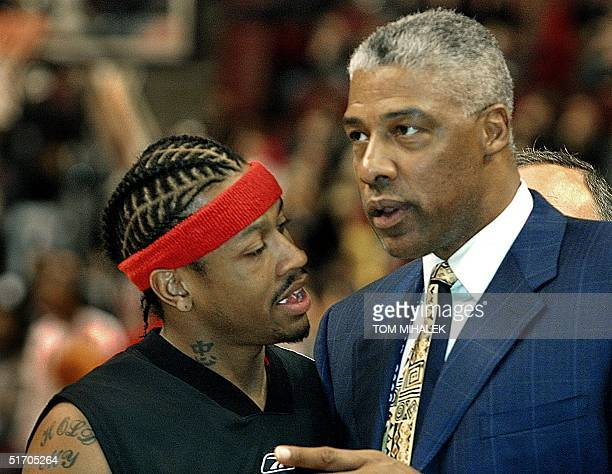 Allen Iverson of the Philadelphia 76ers who played for the East All Stars talks with basketeball legend Julius Doctor J Erving prior to the start of...