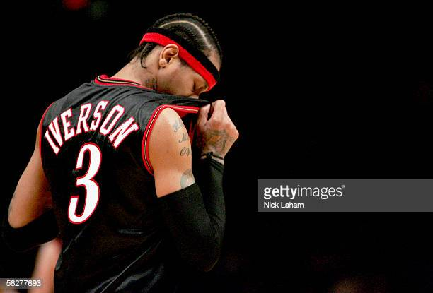 Allen Iverson of the Philadelphia 76ers wipes sweat from his face against the New York Knicks on November 26 2005 at Madison Square Garden in New...