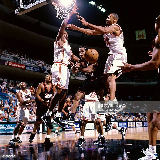 Allen Iverson of the Philadelphia Sixers drives through the lane and passes off against the Miami Heat during a NBA game at the the American Airlines...