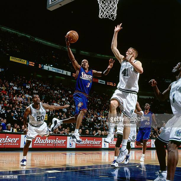 Allen Iverson of the Philadelphia Sixers drives to the basket against the Dallas Mavericks during a NBA game at the Reunion Arena circa 2000 in...