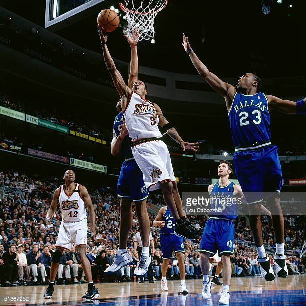 Allen Iverson of the Philadelphia Sixers drives to the basket against the Dallas Mavericks during an NBA game at the First Union Arena in 2000 in...