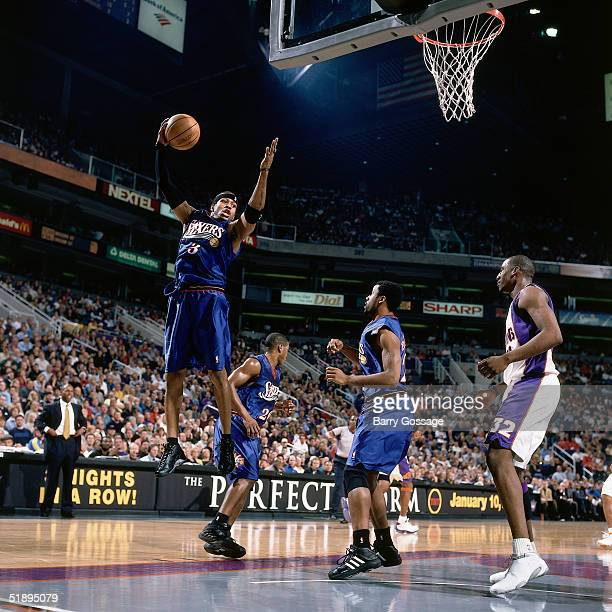 Allen Iverson of the Philadelphia Sixers grabs a rebound against the Phoenix Suns during a NBA game at the The America West Arena in Phoenix Arizona...