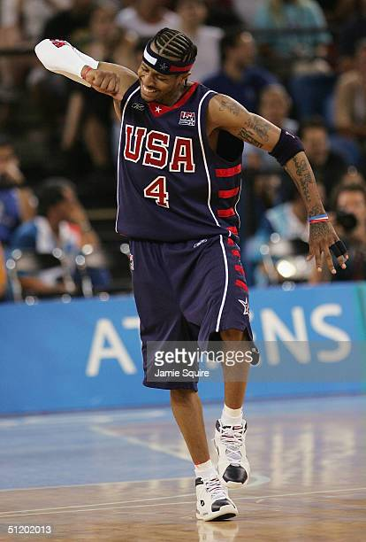 Allen Iverson of the United States gets excited after he hit a late basket to give the USA their last lead against Lithuania in a men's basketball...