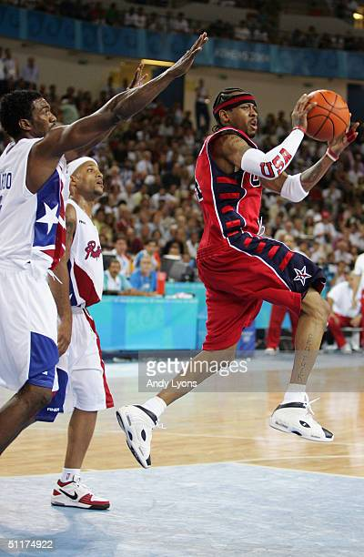 Allen Iverson of the United States looks to pass under pressure from Sharif Fajardo of Puerto Rico competes in the men's basketball preliminary game...