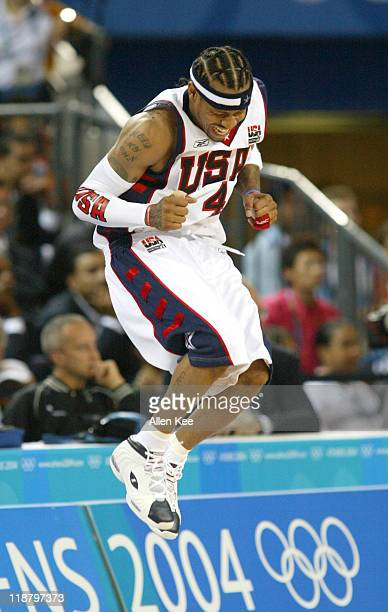 Allen Iverson of the United States reacts after making a shot during the preliminary group B match against Greece at Helliniko Indoor Arena in Athens...