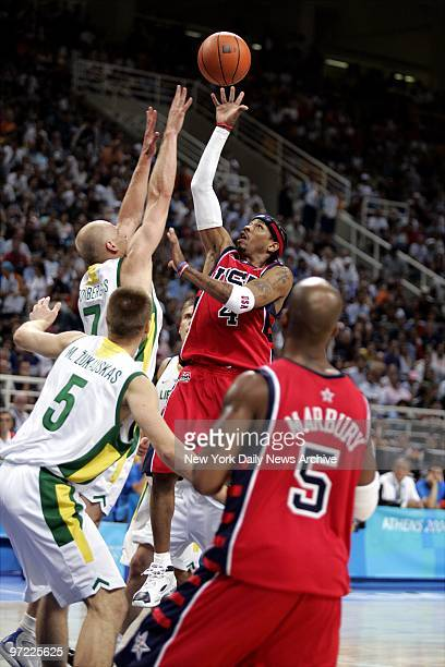 Allen Iverson of the US shoots over Lithuania's Saulius Stombergas as Mindaugas Zukauskas of Lithuania and the US's Stephon Marbury look on during...