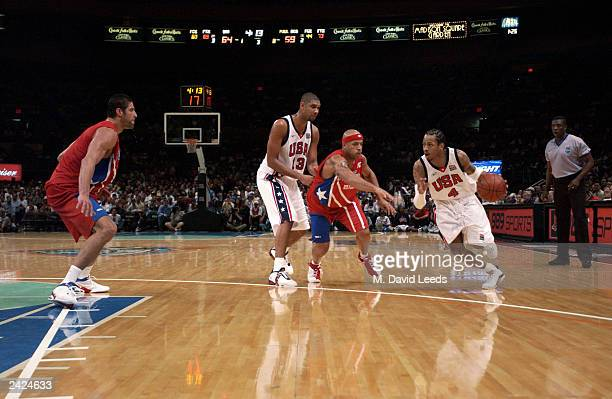 Allen Iverson of the USA drives the ball against Elias Ayuso of Puerto Rico during an exhibition game on August 17 2003 at Madison Square Garden in...