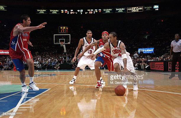 Allen Iverson of the USA drives to the basket past Elias Ayuso of Puerto Rico during an exhibition game on August 17 2003 at Madison Square Garden in...