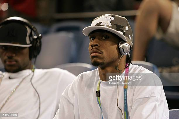 Allen Iverson of the USA men's basketball team watches the USA women challenge South Korea on August 18 2004 during the Athens 2004 Summer Olympic...