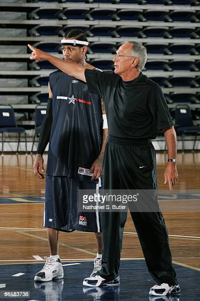 Allen Iverson of the USA Olympic Men's Basketball Team listens to instructions from head coach Larry Brown during day two of practices in preparation...