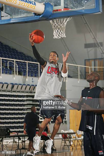 Allen Iverson of the USA Olympic Men's Basketball Team shoots a layup in front of teammate Lamar Odom during day one of practices in preparation for...