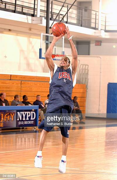 Allen Iverson of the USA Senior Men's National Team takes a jumpshot during practice at John Jay College on August 10 2003 in New York City NOTE TO...