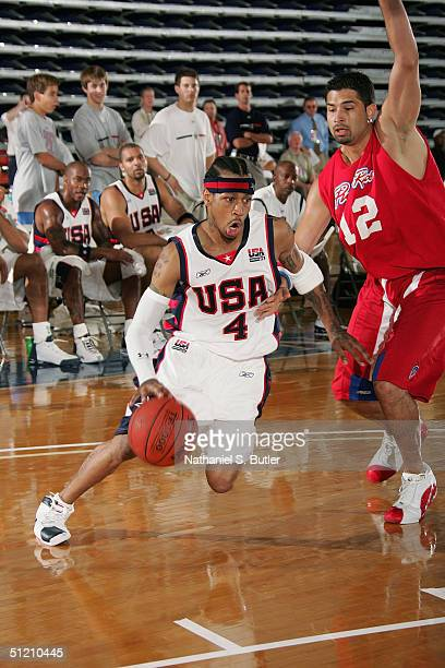 Allen Iverson of the USA Senior National Men's Team USA drives around Rolando Hourruitiner of Puerto Rico during the exhibition game at University of...