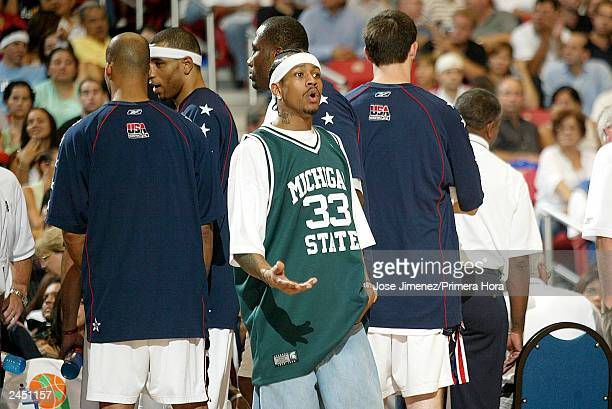 OUT*** Allen Iverson of the USA stabds amongst his teammates during a break in the action as the USA plays Argentina during the gold Medal game of...
