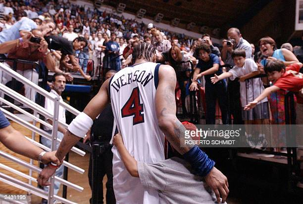 Allen Iverson of US hugs his son Allen Iverson Jr as he leaves the basketball court at the Roberto Clemente Coliseum in San Juan Puerto Rico 26...