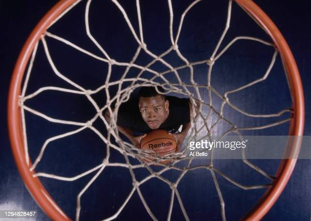 Allen Iverson, Shooting Guard and Point Guard for the Philadelphia 76ers looks up through the net of the basketball hoop during a photoshoot for...