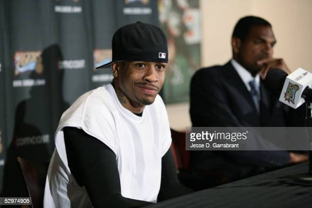 Allen Iverson sits with Maurice Cheeks as Cheeks is named head coach of the Philadelphia 76ers on May 24 2005 at the Wachovia Spectrum in...