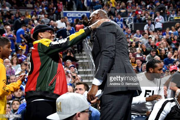 Allen Iverson talks with Magic Johnson during the game between the Philadelphia 76ers and the Los Angeles Lakers on February 10 2019 at the Wells...