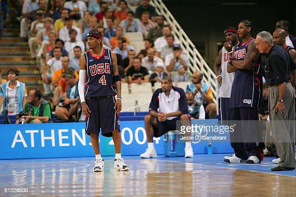 Allen Iverson Tim Duncan LeBron James Carmelo Anthony and Head coach Larry Brown of the USA dejected over their loss to Argentina during the mens'...