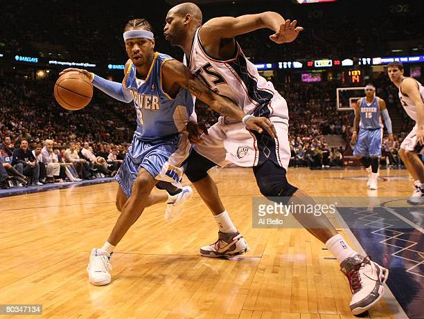 Allen Iverson#3 of the Denver Nuggets drives to the basket as Vince Carter of the New Jersey Nets defends during their game on March 21 2008 at the...