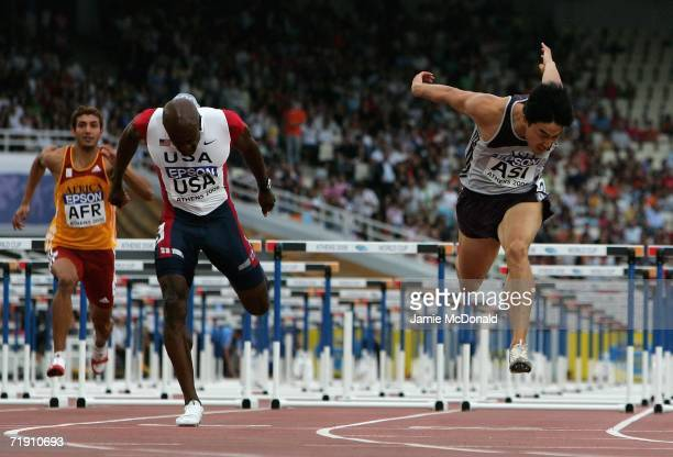 Allen Johson of the USA and Xiang Liu of China race to the finnish line in the 110m Hurdles event during the 10th IAAF World Cup in Athletics on...