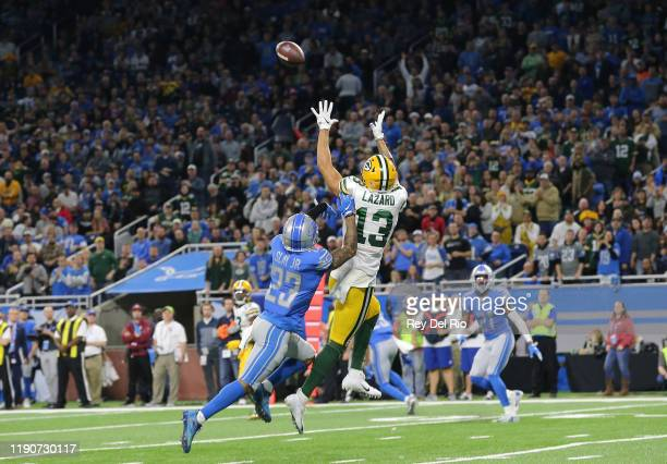 Allen Lazard of the Green Bay Packers catches a fourth quarter touchdown pass in front of Darius Slay of the Detroit Lions at Ford Field on December...