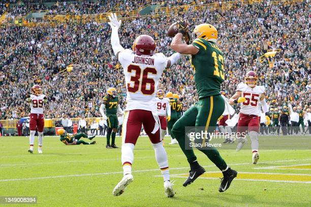 Allen Lazard of the Green Bay Packers catches a pass for a touchdown in front of Danny Johnson of the Washington Football Team at Lambeau Field on...