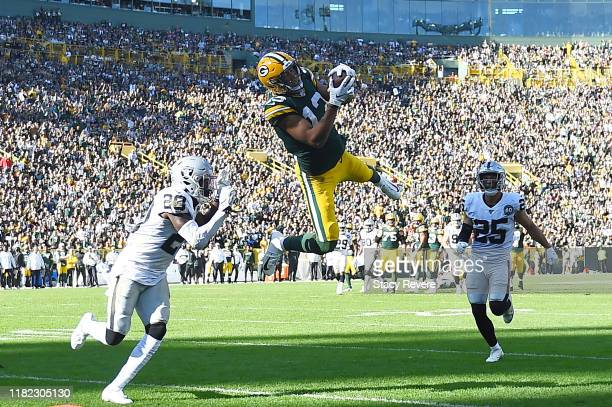 Allen Lazard of the Green Bay Packers catches a pass in front of Daryl Worley of the Oakland Raiders during the third quarter of a game at Lambeau...