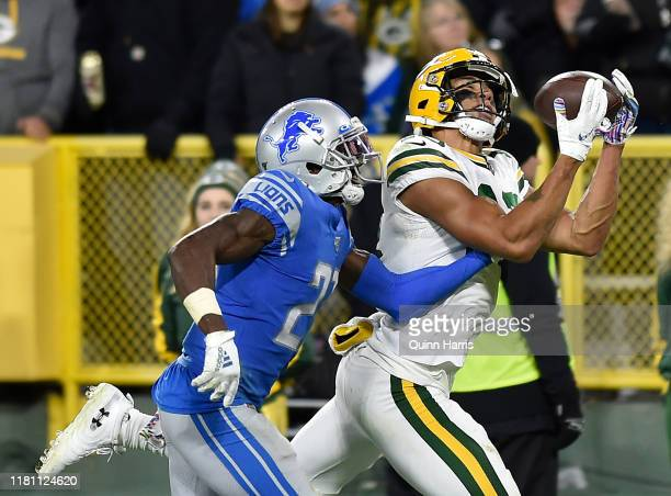 Allen Lazard of the Green Bay Packers catches a touchdown in the fourth quarter Justin Coleman of the Detroit Lions at Lambeau Field on October 14...