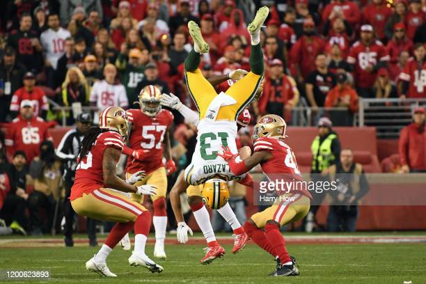 Allen Lazard of the Green Bay Packers is tackled by Emmanuel Moseley of the San Francisco 49ers in the first half during the NFC Championship game at...
