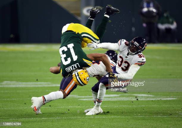 Allen Lazard of the Green Bay Packers is upended by Buster Skrine and Aaron Jones of the Green Bay Packers after making a catch during the 1st...