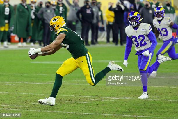 Allen Lazard of the Green Bay Packers makes a 58-yard touchdown reception in the fourth quarter against the Los Angeles Rams during the NFC...