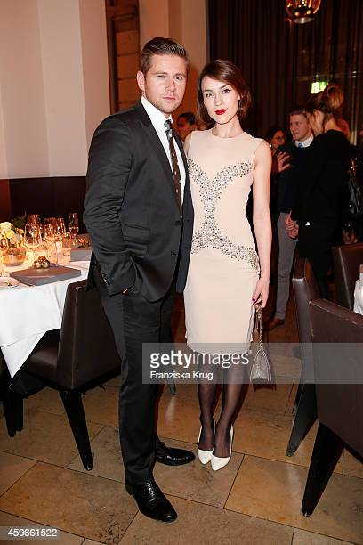 Allen Leech and Ella Catliff attend the Mulberry Store Opening on November 27 2014 in Frankfurt am Main Germany