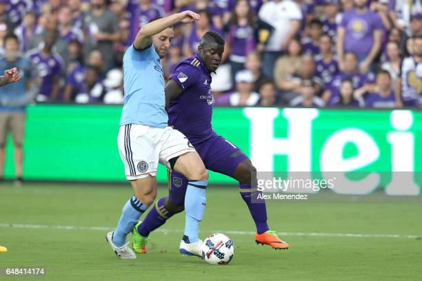 Allen of New York City FC and Carlos Rivas of Orlando City SC fight for the ball during a MLS soccer match between New York City FC and Orlando City...