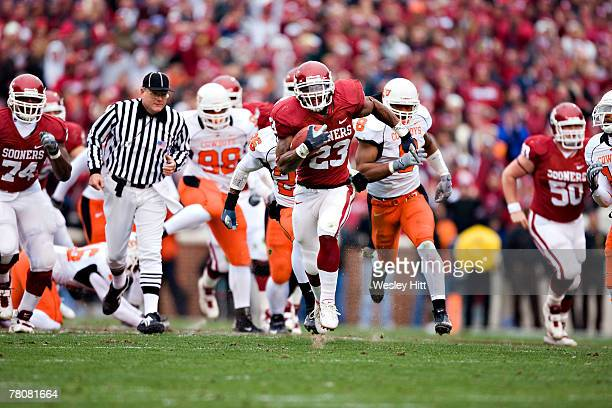 Allen Patrick of the Oklahoma Sooners runs with the ball against the Oklahoma State Cowboys at Gaylord Family-Oklahoma Memorial Stadium November 24,...
