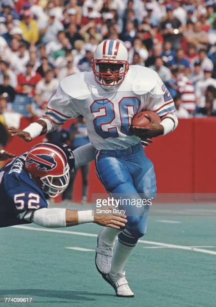 Allen Pinkett Running Back for the Houston Oilers runs the ball as John Kaiser Linebacker for the Buffalo Bills tries to tackle him during their...