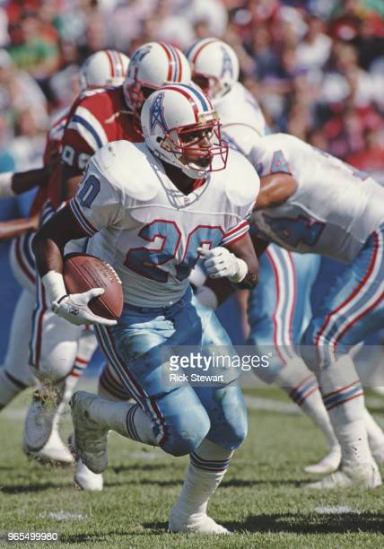 Allen Pinkett Running Back for the Houston Oilers runs the ball during the American Football Conference East game against the New England Patriots on...